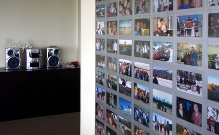 Silver fridgi magnetic photo frames covering a photo wall